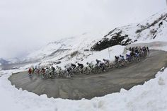 The peloton descends the first climb