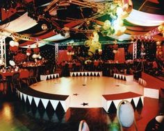 Birthday Party or Corporate Event. Staged Circus Arena in the middle of the dance floor. Drapery, Stage Barriers, Balloons, Table décor and balloons.