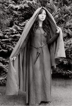"""Representation of Irish dress: """"16th century impression of a rural Gaelic woman featuring reconstructions of the Moy Gown and a Brat which are copies of artifacts in the National Museum of Ireland."""""""