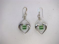 Open heart  earrings in sterling silver with twisted silver wire and swarovsk crystals in peridot cubes. Handmade.