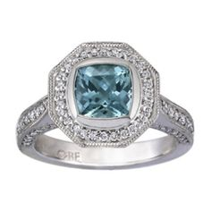 Seafoam Cushion Sapphire Luxe Bezel Halo Ring from Brilliant Earth