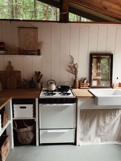 Unplugged: A Young Couple's DIY, Totally Off-the-Grid Cabin in the New Hampshire Woods - Remodelista - Cabin interiors - Home Design, Home Interior Design, Hampshire, Off Grid Cabin, Off The Grid Homes, Cabin In The Woods, Little Cabin, Farmhouse Lighting, Cabin Lighting