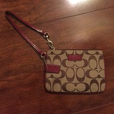 "Brown and maroon Coach Wristlet, Never Used! 💯 💯 authentic Coach wristlet. Inside two credit card pockets Zip-top closure, fabric lining Strap with clip to form a wrist strap or attach to the inside of a bag 6 1/4 "" (L) x 4 1/2"" (H) Coach Bags"