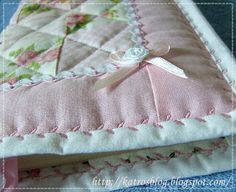 Machine binding with a decorative stitch. So pretty, would be perfect for a baby quilt.