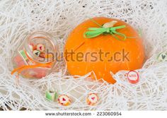 pumpkin candy jar love heart white background  - stock photo