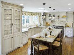French Country Kitchens : Kitchen Remodeling : HGTV Remodels | Loving the bay window at the sink. Need to add this to my home to let some light into the kitchen. {And move the sink to the north wall!}