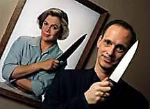 John Waters, with pic from his film Serial Mom.