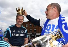 Jose Mourinho wears the crown from the Premier League trophy as he parties on the top deck of the team bus