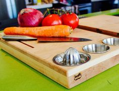 Upgrade your new kitchen with The Ultimate Cutting Board. This wooden block is actually an all in one preparation and cooking station.
