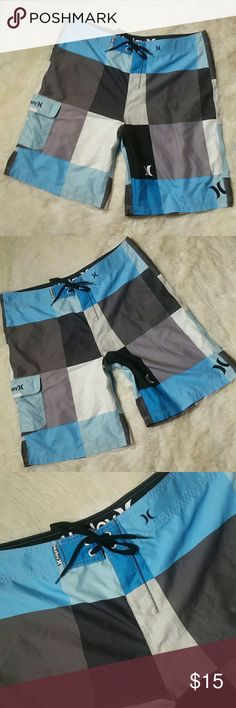 """Mens Hurley Board Shorts Swim Shorts Size 38 New with tags. HURLEY boardshorts. Bought these for my husband years ago, wrong size. Have never been worn, washed or swam in. Side velcro pocket at the leg. Drawstring closure. Size 38.   Waist 20"""" Length top to bottom 23"""" Hurley Swim Board Shorts"""