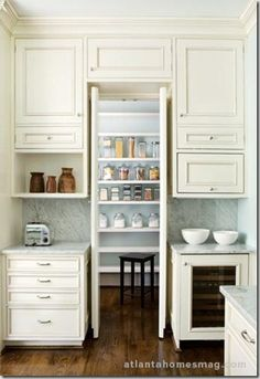 """I like the idea of the hidden pantry. I think it would be cooler if the doors/walls came out to be flush with the other cabinets. Would look like floor to ceiling cabinets, but would reveal the """"secret"""" pantry once opened."""