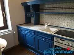 Blick in die Küche, die unsere Lackarbeit an der Sonderanfertigung zeigt - Malereibetrieb aus Bremen!