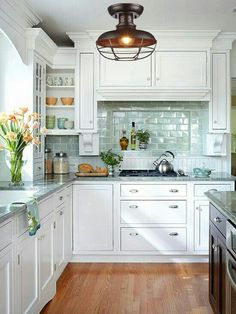 A backsplash and a kitchen stove should work together as a coherent design piece to create a focal point in your kitchen. Here's helpful information for choosing materials and designs for a kitchen stove backsplash. Kitchen Stove, New Kitchen Cabinets, Kitchen Cabinet Design, Kitchen Flooring, Kitchen Decor, Kitchen Ideas, White Cabinets, Kitchen Appliances, White Appliances