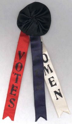 "Suffrage Rosette with Ribbon Tails Imprinted with the Phrase ""Votes For Women"" (1915)"