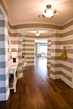 Giada's bathroom - these thick gray and white stripes on the wall  Like the floor color for rest of the house