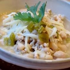 White Chili with Ground Turkey - Allrecipes.com however I am substituting Turkey for chicken chucks.