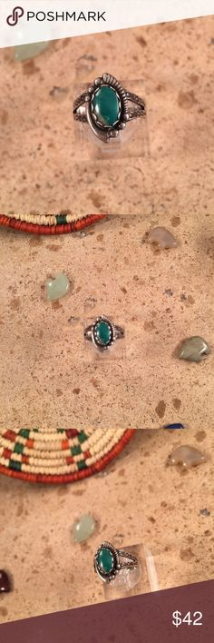 Vintage Navajo Turquoise & Sterling Silver Ring Authentic vintage Navajo Sterling Silver & Turquoise ring size 5.5. This ring is in excellent vintage condition. The ring is right at 5/8 of an inch long and 3/8 of an inch wide.  Thank you for looking, please contact me with any questions. Jewelry Rings