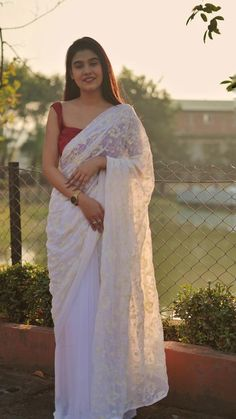 This is a lovely floral embroidered fine georgette saree in white. Organza Saree, Georgette Sarees, Kurti, Shiffon Saree, Saree Sale, Saree Poses, Traditional Silk Saree, Saree Photoshoot, Stylish Sarees