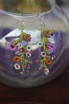 beaded daisy earrings - basic coral stitch with daisy at the end, an occasional leaf thrown in.  Quite doable!