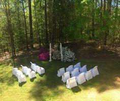 Small backyard spring wedding ceremony setup