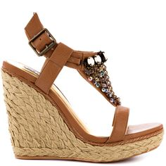 They'll bow down when you have the Domestic Goddess on your feet.  This Not Rated sandal features a tan faux leather upper with sequin and jewel design at the vamp.  A 5 inch wedge and 1 inch platform is detailed with a woven espadrille.