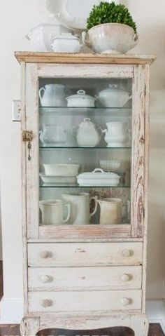 pink painted, distressed cabinet with drawers, rustic