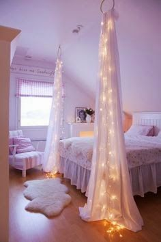 I love this curtain with the lights. Pretty and soft, and a way to point out my lovely tall ceilings.