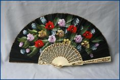 A very pretty hand painted Italian plastic and fabric fan.