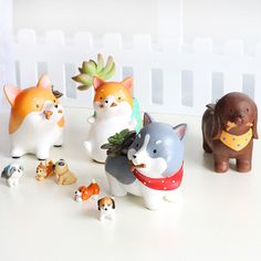 These mini Shiba Inu planters are simply adorable! Perfect for succulents, herbs, flowers, or whatever else you can think of, these cheerful pots will bring joy to any place you put them. They are gre