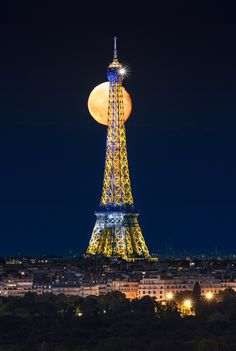 The moon and the Eiffel Tower - Paris, France by Antonio GAUDENCIO…