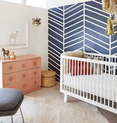 Nursery with Herringbone Accent Wall + Coral Dresser = too sweet!
