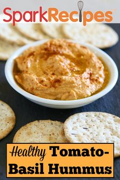 Basil and Sun-Dried Tomato Hummus. This is ABSOLUTELY divine! And so easy to make! | via @SparkRecipes #snack #homemade #hummus #delicious