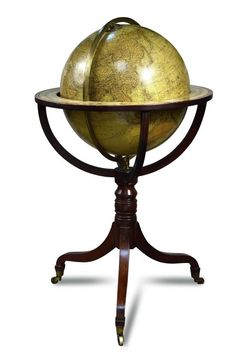 Sale F251115 Lot 590  A Bastien terrestrial library globe, modern, on a Regency style mahogany stand with brass casters, 106cm (41.5in) high, together with a reproduction Cary terrestrial 12 inch globe on an earlier mahogany tripod stand with compass below  - Cheffins