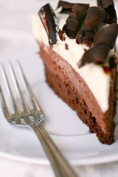 Triple Chocolate Mousse Cake. The bottom layer is a sort of flourless chocolate cake, the middle is a silky chocolate mousse and the top layer is light yet rich white chocolate mousse.