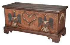 """Rare American Federal Red, White &  Blue Paint-Decorated Lift-Top Chest probably Southern states, underside of lid initialed & dated """"IS/1803"""", white pine throughout, hinged lid with open interior with till & hidden compartment, front boldly painted with central heart flanked by spread-wing federal eagles, sides with white crescent moons on red ground, interior floor of bottom board with two inscribed peacock designs, 24 x 49-1/4 x 21 in."""