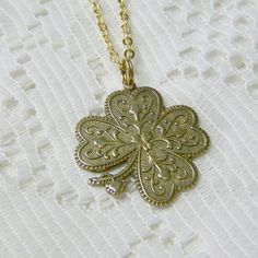 Antiqued Gold 4 Leaf Clover Necklace  LUCKY by SouthernBelleOOAK, $20.00
