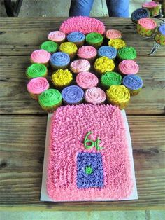 Bubble gum machine made from cake & cupcakes.