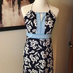 """Super cute blue and white print LOFT dress. Blue and white floral pattern.  Side zip with adjustable neck tie. 100% polyester- machine wash.  Perfect for summer bbq or casual lunch! Bust measurement 18"""" laid flat. LOFT Dresses Midi"""