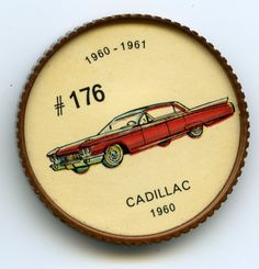 Jello-O Coin 176 - Cadillac (1960) - Basic body lines remained the same in the 1960 Cadillac as in the 1959 model, although the rear fender fins were less radical in shape. A boon to absent-minded drivers was the parking brake, which was released automatically when the car was put into gear. Two V-8 engines were offered in the 13 models produced—325 or 345 horsepower