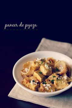 paneer do pyaza recipe with step by step photos. rich and tasty mughlai dish of soft succulent paneer cubes in a creamy semi dry gravy.