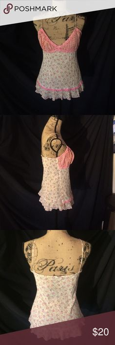 Pink floral camisole Like new white and pink floral camisole. Spaghetti straps. Small lace and bead detailing. Bought at a little boutique in Breckinridge Colorado. Receives tons of compliments and is very unique. Tops Camisoles