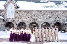 These bridesmaid dresses and calla lilies in the bride's bouquet are the only traces of bright purple in this soft blush and gold winter color palette. See more pictures from this wedding that took place at Castle Farms in northern Michigan.