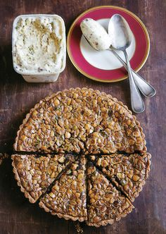 This rustic tart, filled with toasted pistachios, hazelnuts, and pine nuts, is a wonderful take on pecan pie.    Read More http://www.bonappetit.com/recipes/2011/11/toasted-nut-tart#ixzz1guQaZohQ
