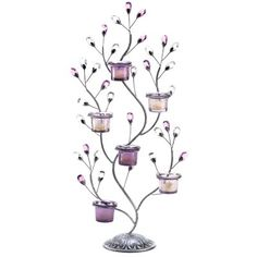 Lustrous gems glitter amongst twining branches and candlelight! Graceful tree-shaped accent holds six tealight candles in a striking configuration that enlivens any setting. Weight 2 lbs. 11 3/4x 5 1/2x 24 3/4high. Iron, glass and acrylic. Candles not included. UPC# 817216010798.