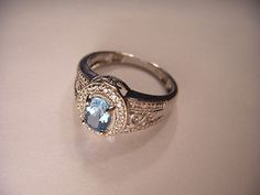 Present your best items with Auctiva's FREE Scrolling Gallery. Generic40 Beautiful Estate 14K White Gold Blue Topaz Diamond Filigree Ring Band - - - - 14K white gold blue topaz diamond ring. This gorg