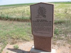 This red granite historical marker is 4 miles west of Hollis, Oklahoma on the Oklahoma/Texas border. It marks the 100th meridian, which originally was the boundary between the Republic of Texas and territory in the Louisiana Purchase. Visit willisgranite.com to see our other historical markers!