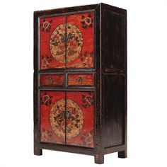 Truly handsome tall painted Chinese cabinet based on the simple red and black lacquer painted furniture of eastern Gansu province. Each set of doors is in red lacquer, decorated with a pretty central circular design of flowers, contrasting with the black lacquer frames. Great as a drinks cabinet, or for bedroom storage.