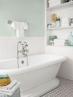 Turquoise accents, white towels and soft sea green walls make a relaxing color palette in this beach bathroom.