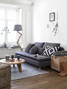 I love the style of this living area, again though, im not a fan of white but maybe another color can fit well with the grays has i am a fan of that