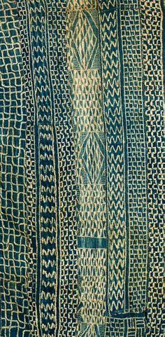 Cameroon ~ chief's ndop cloth ~ Symbolic The decoration and the reasons Ndop allow the garment maker, embroiderer, transcribe messages. Geometric shapes, moon, sun, stars, animals ... are coded messages of peace, fertility ...